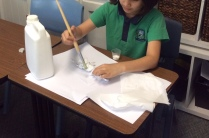 A student making a dragon for a Green screen movie.